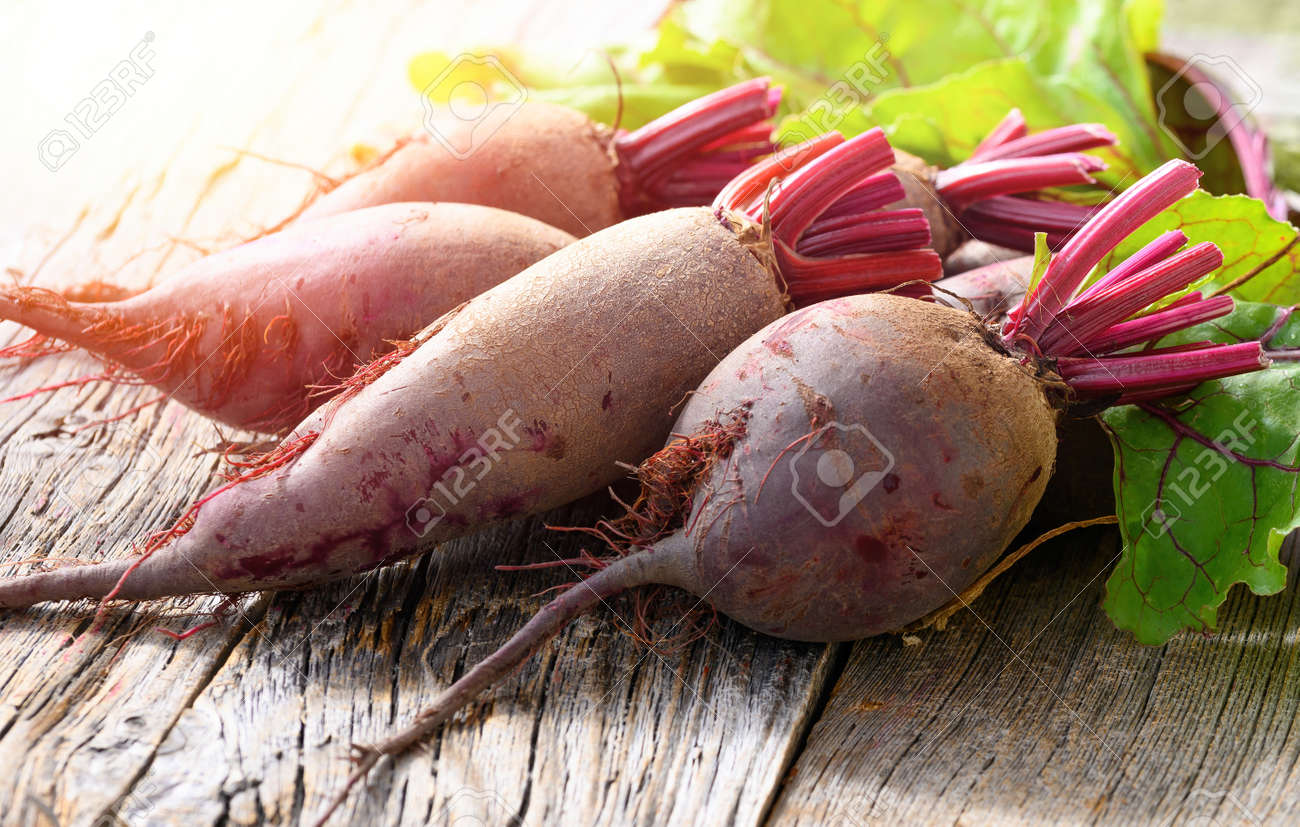 Red Beets on wooden rustic background. Organic Beetroot. - 172150488