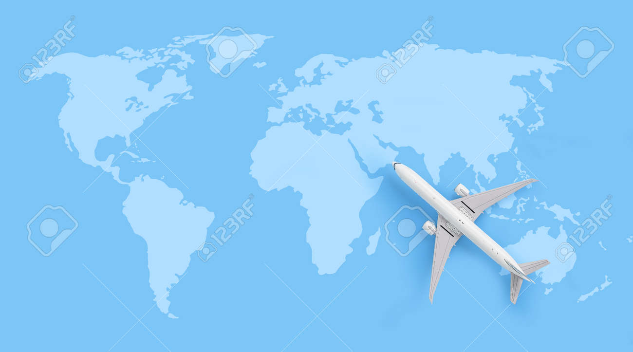 Traveling concept , white aircraft model on world map - 172311975