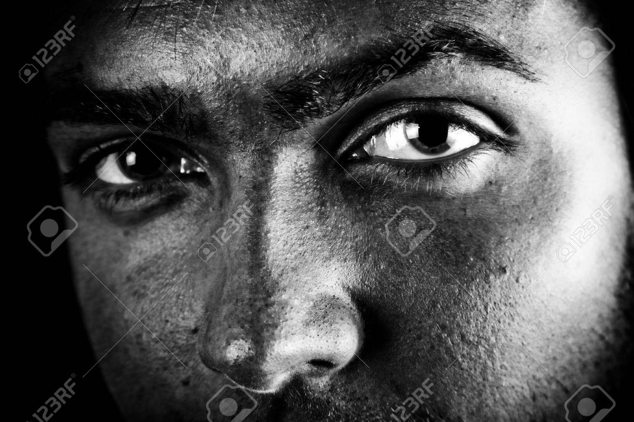 Man with intense eyes high contrast black and white