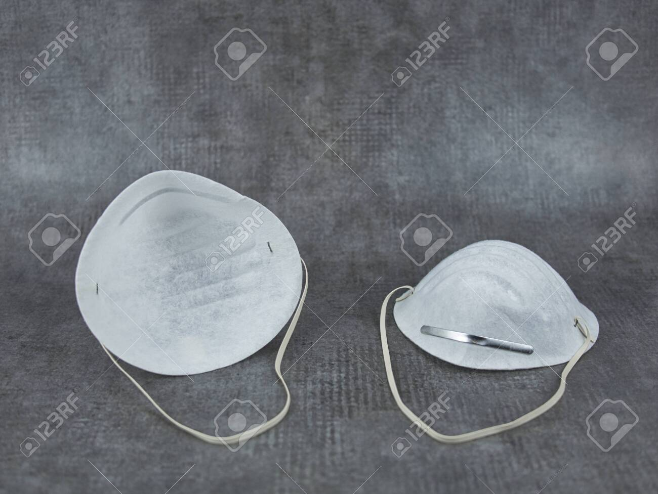 Two Face Masks With Metal Temples For The Nose And Elastic Bands