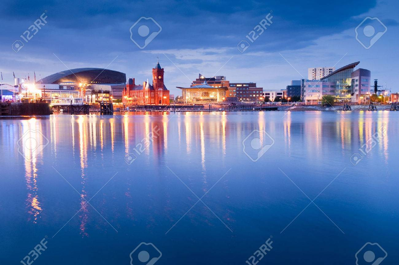 Pretty night time illuminations of the stunning Cardiff Bay, many sights visible including the Pierhead building (1897) and National Assembly for Wales. - 29678482