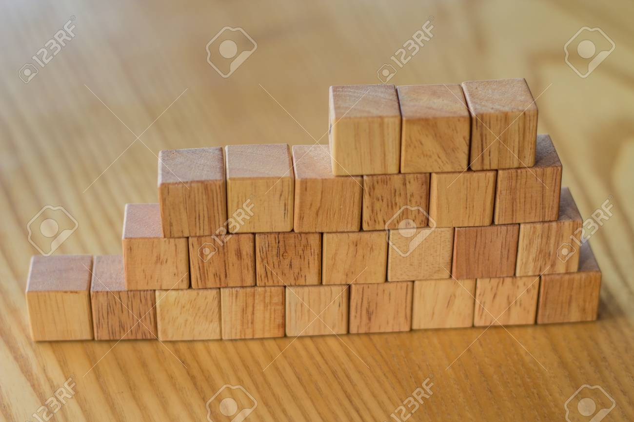 Building a wall from wooden bricks for construction or landscaping