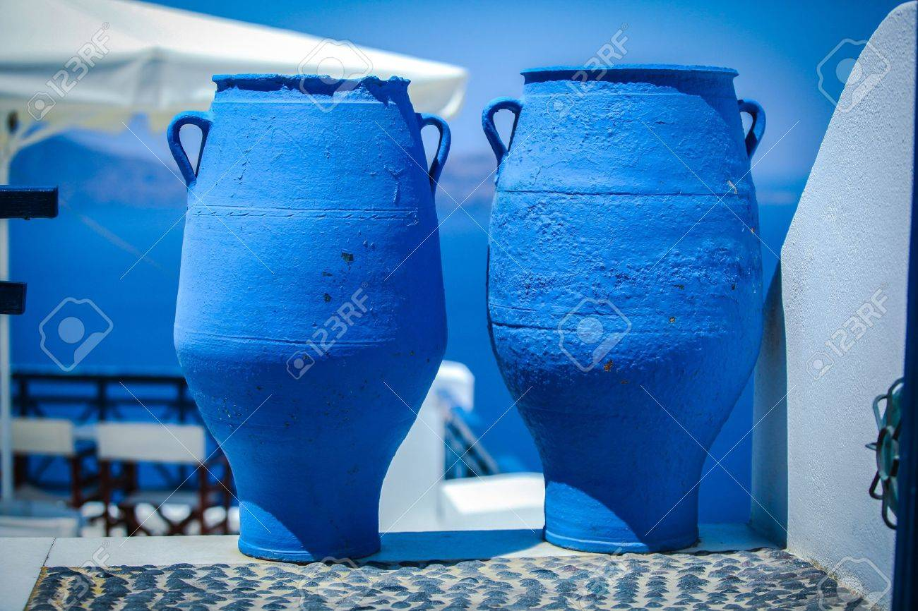 Traditional two large blue bins in the Greek village Stock Photo - 20537383