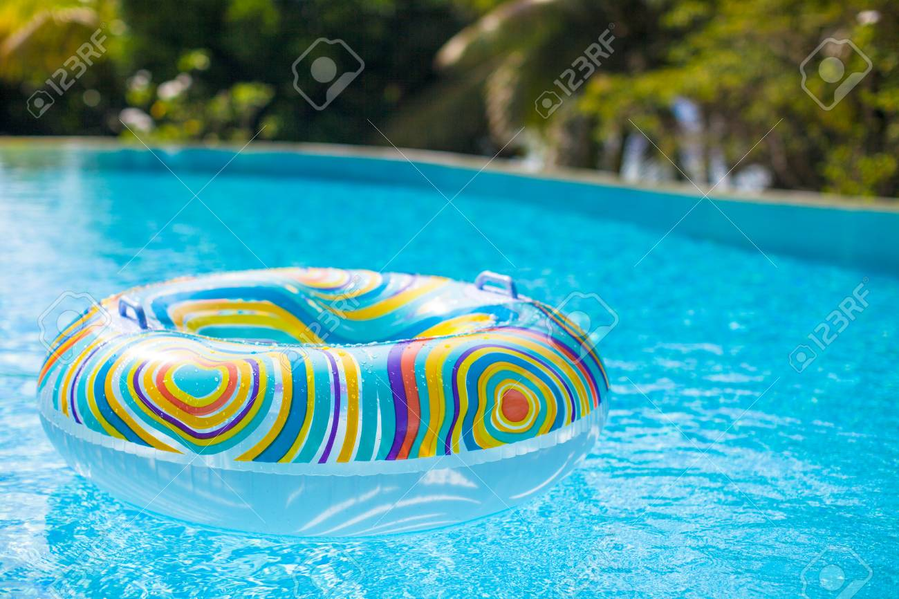 Colorful pool float in blue swimming pool