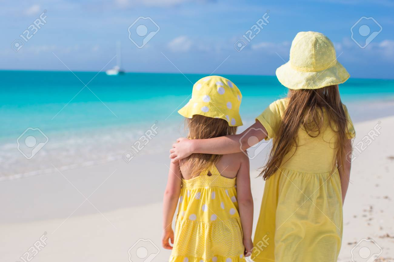 Back view of two little girls on caribbean vacation Stock Photo - 27890604