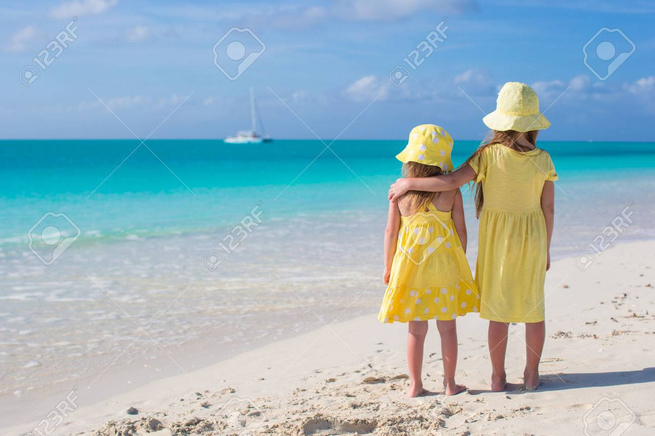 Back view of two sisters looking at the sea on the white beach Stock Photo - 27890697