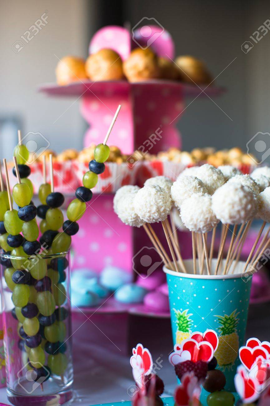 Canape Of Fruit White Chocolate Cake Pops And Popcorn On Sweet Childrens Table At Birthday