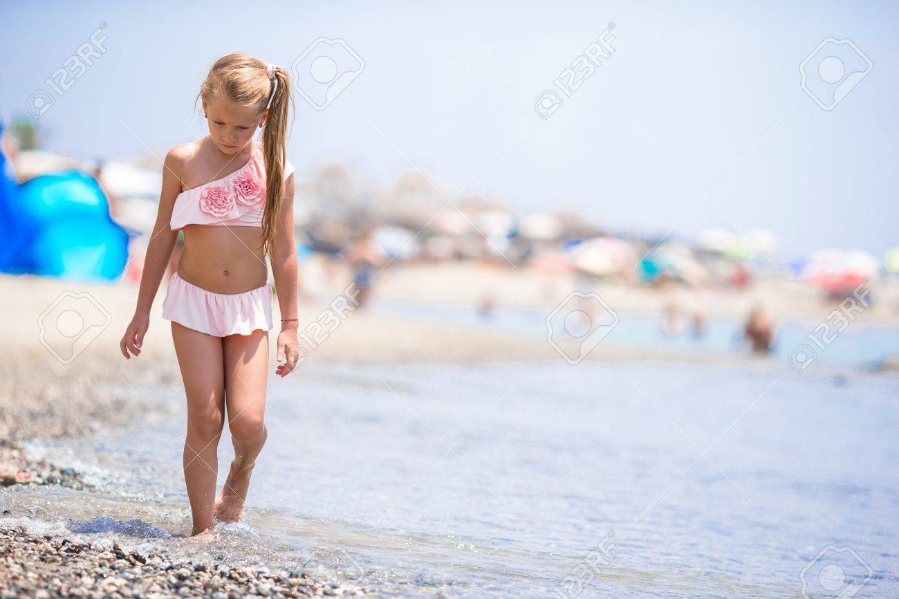 be8887406c9 Cute little girl at beach during summer vacation Stock Photo - 43128840