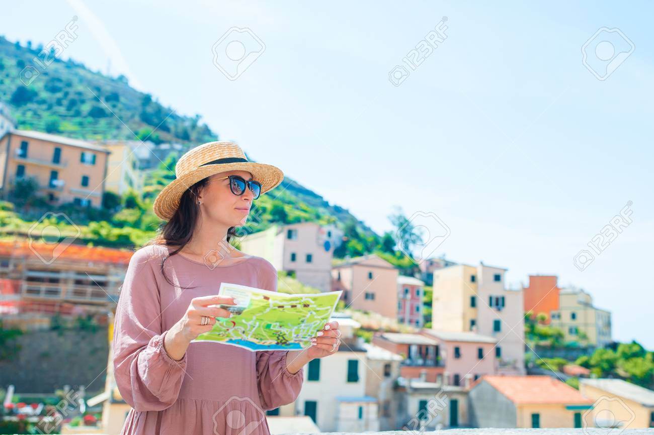Riomaggiore Italy Map.Young Woman With Map At Old Village Riomaggiore Cinque Terre