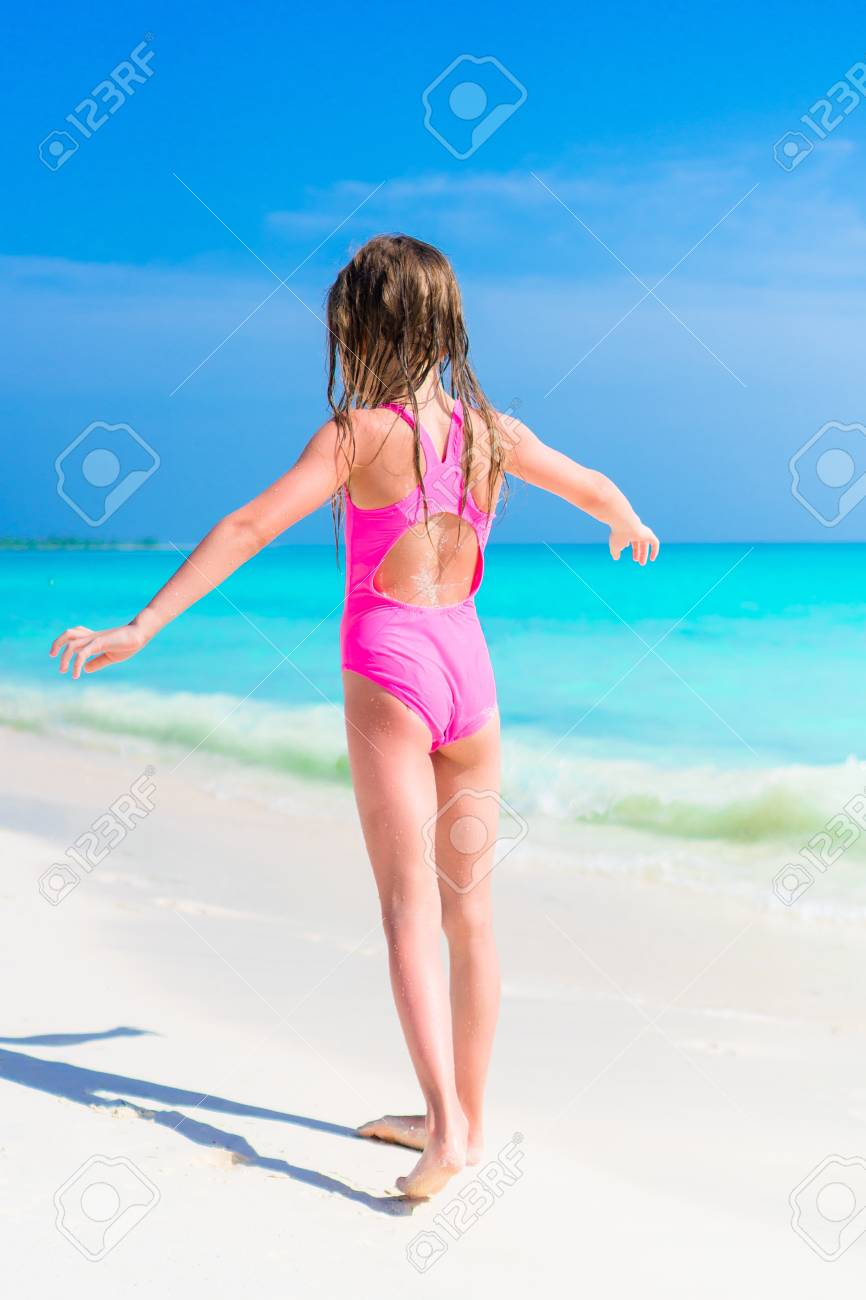 Adorable Little Girl In Swimsuit On Beach Vacation Stock Photo Picture And Royalty Free Image Image 91469647