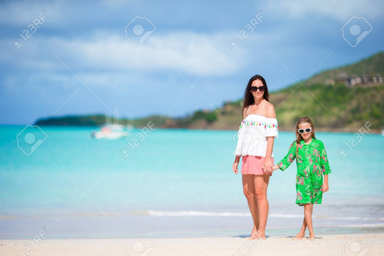 5719d6855b557 Beautiful mother and daughter at Caribbean beach enjoying summer vacation  Stock Photo - 94588513