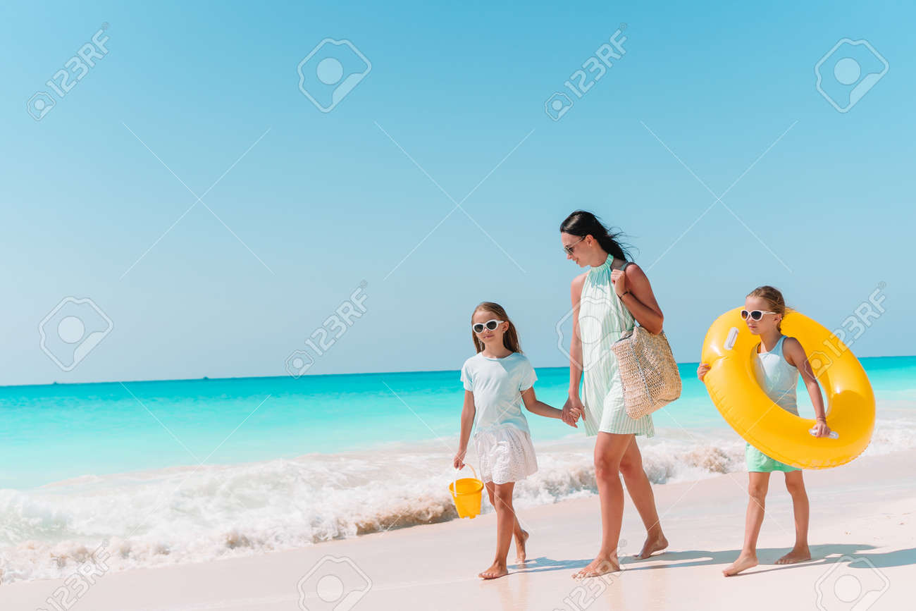 Family of mother and kids on summer vacation on white tropical beach - 144004552