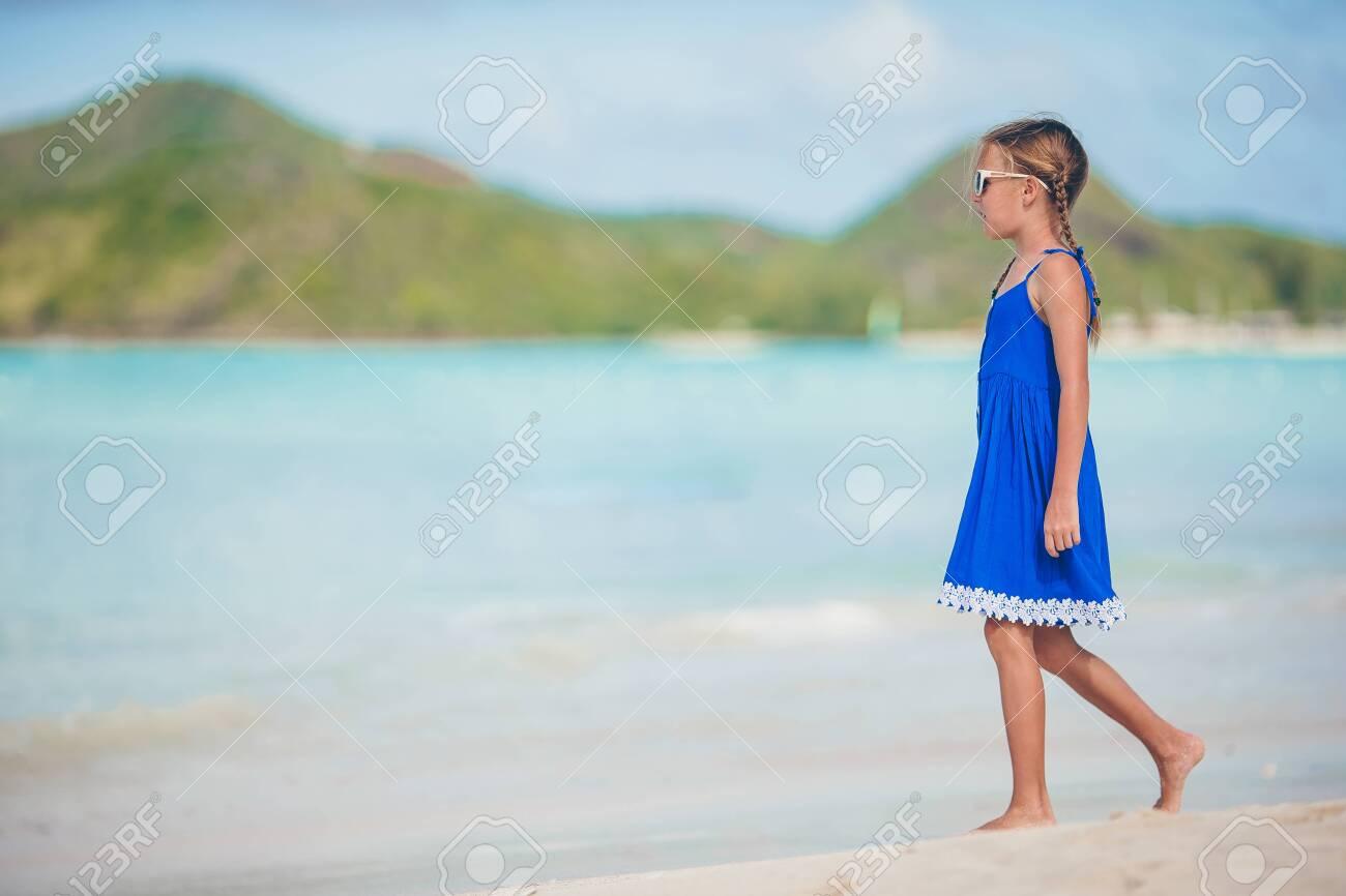 Portrait of beautiful girl on the beach dancing - 121399400