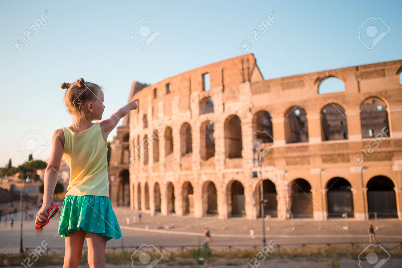 Young girl in front of Colosseum in rome, italy - 122938883