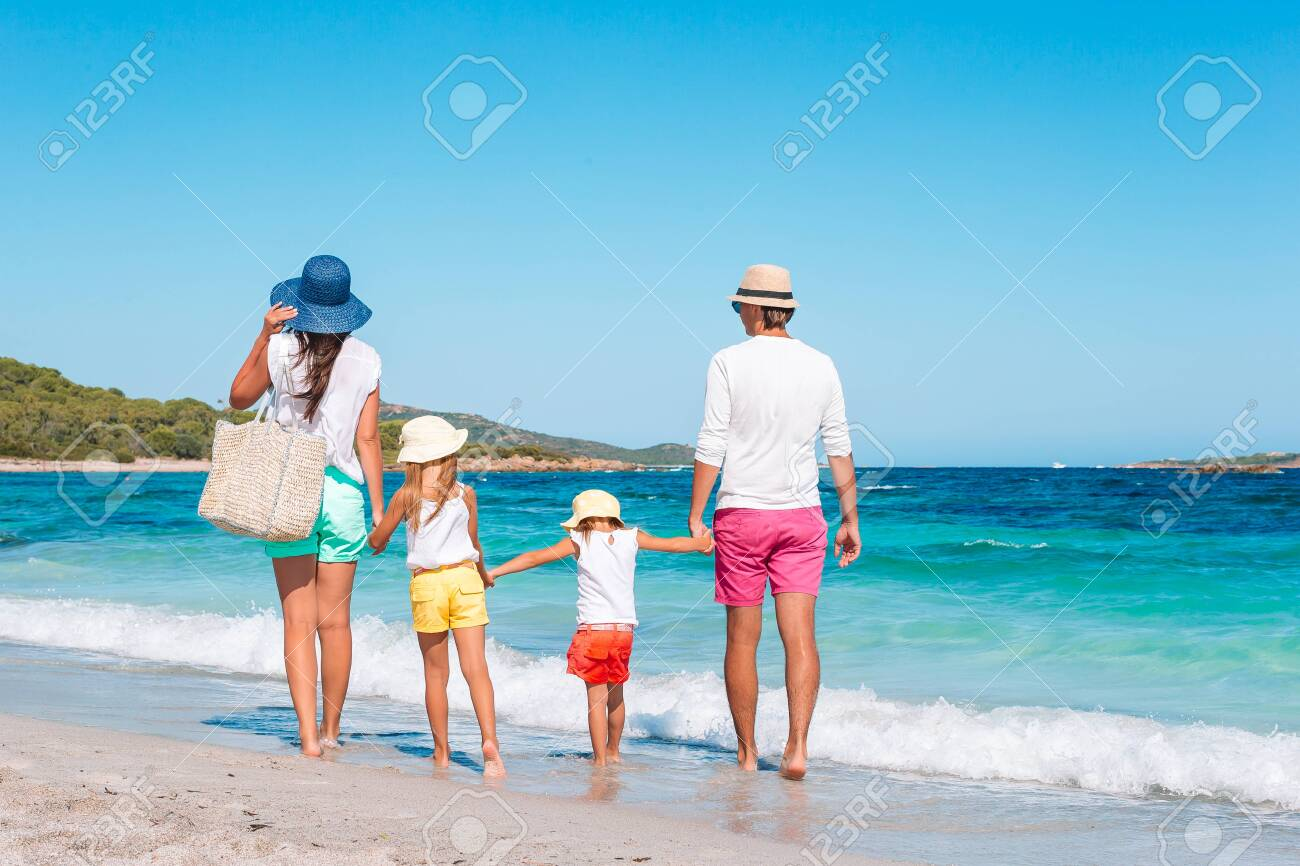 Happy beautiful family on white beach. Back view. - 135556159