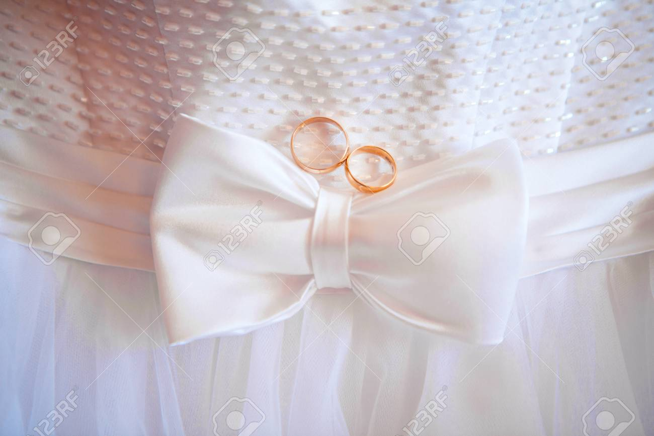Two Rings And Wedding Dress. Bow At The Waist. Stock Photo, Picture ...