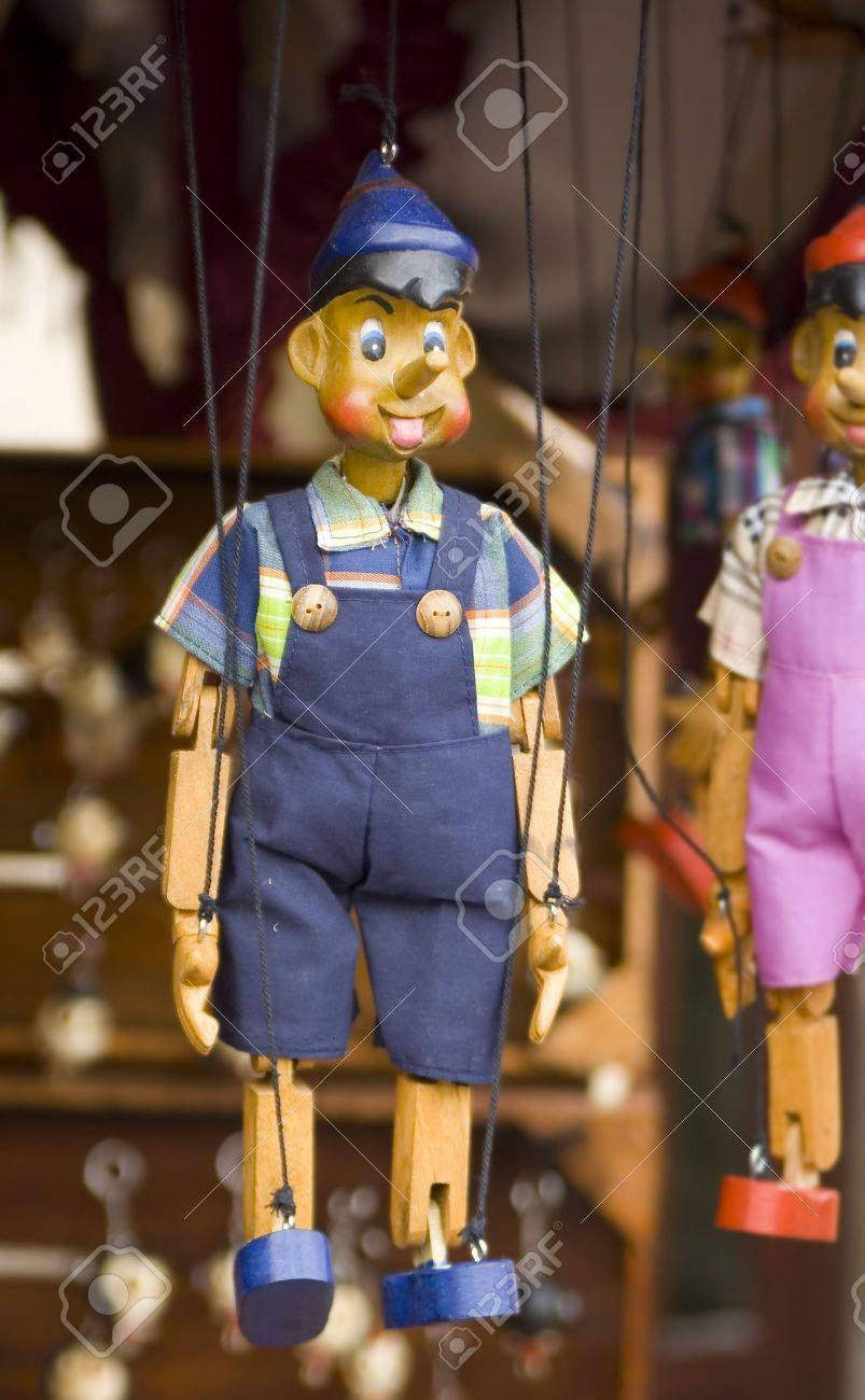 wooden toy puppet marionette string controled pinocchio Stock Photo - 3181714