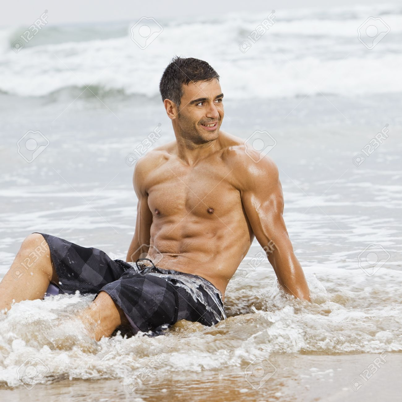 sexy caucasian fit man posing in a beach Stock Photo - 7419361