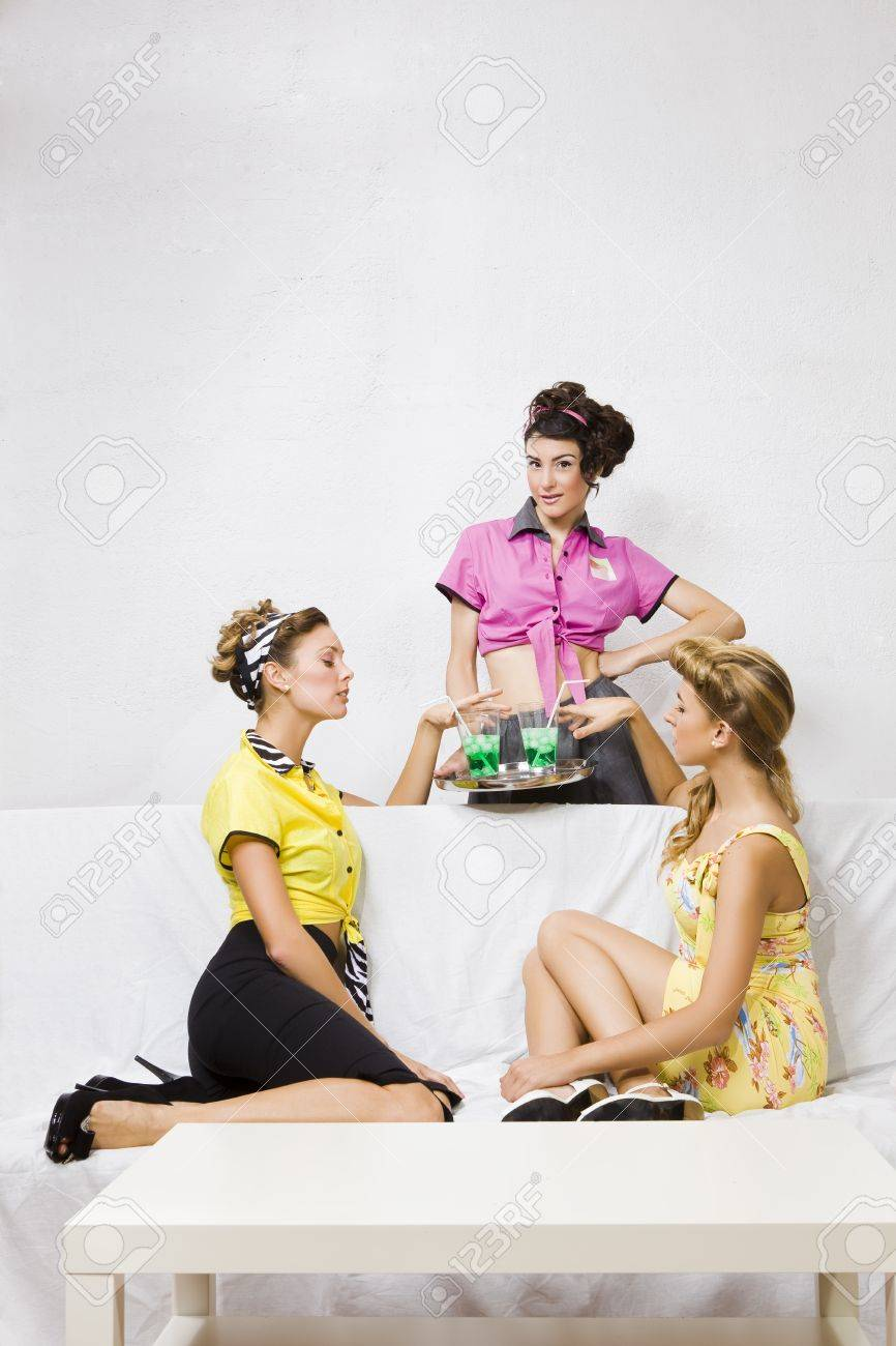 a group of pin-up girls drinking something in a bar Stock Photo - 9176550