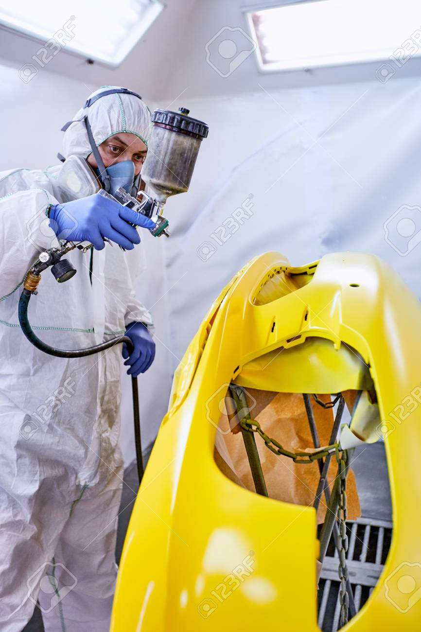 Coloring The Parts Of The Yellow Machine In The Paint Shop Stock