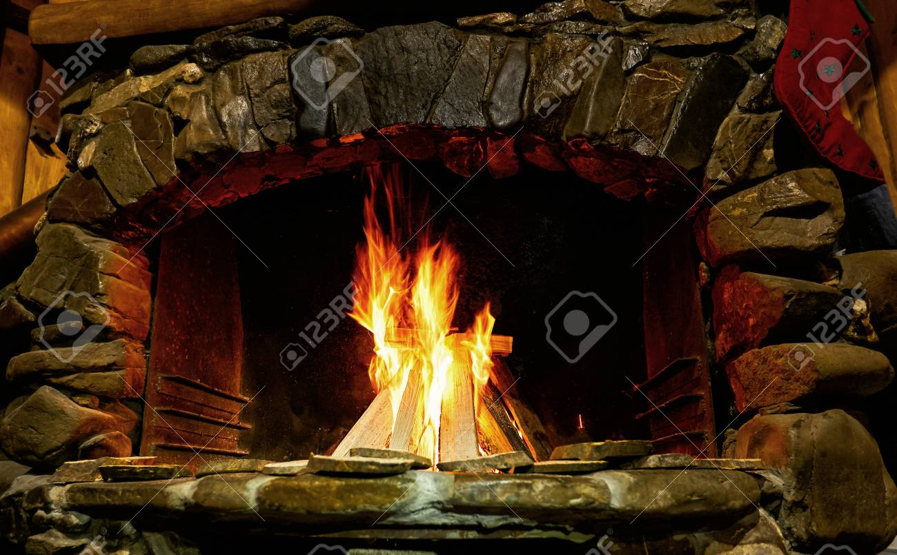 Burning Of A Tree In A Brick Fireplace Fireplace With Flaming Fire