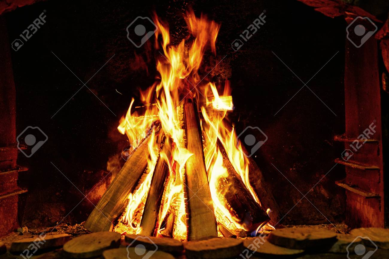 Burning Firewood On A Dark Background In The Fireplace Royalty