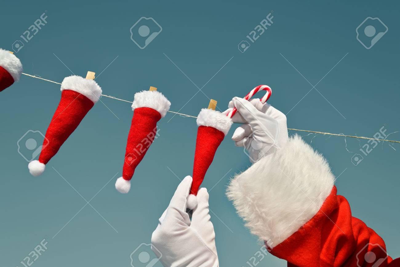 3c95125ee3358 Christmas on line - XXXXS Santa Hats - Santa Claus filling candy cane in mini  Santa