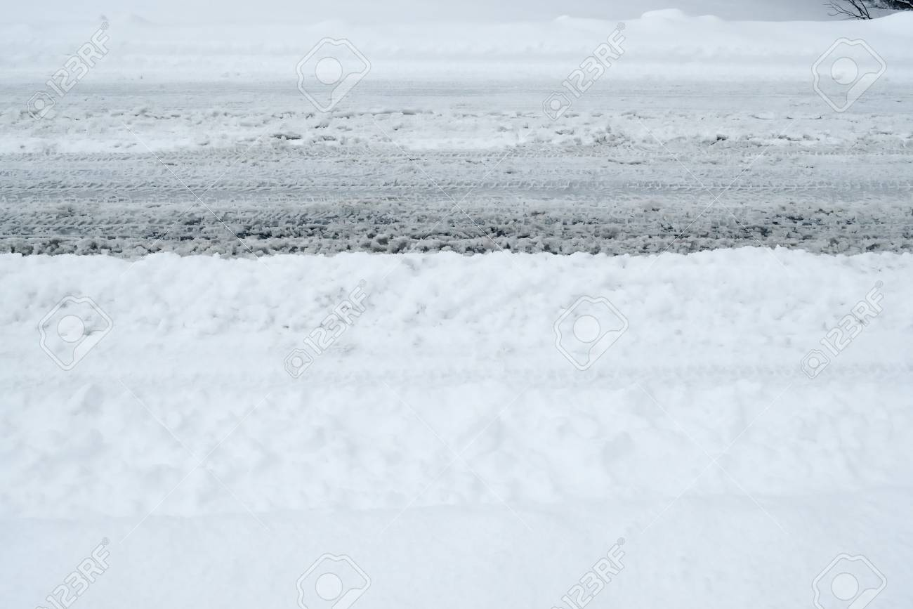Winter Driving Background - snowy road with tire tracks - 113081634