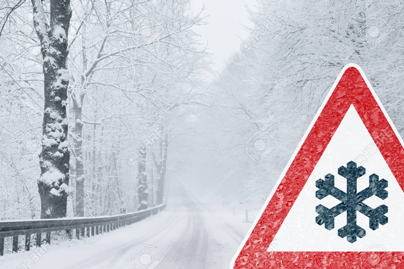 Winter Driving - Snowy Road with Warning Sign - 113081639