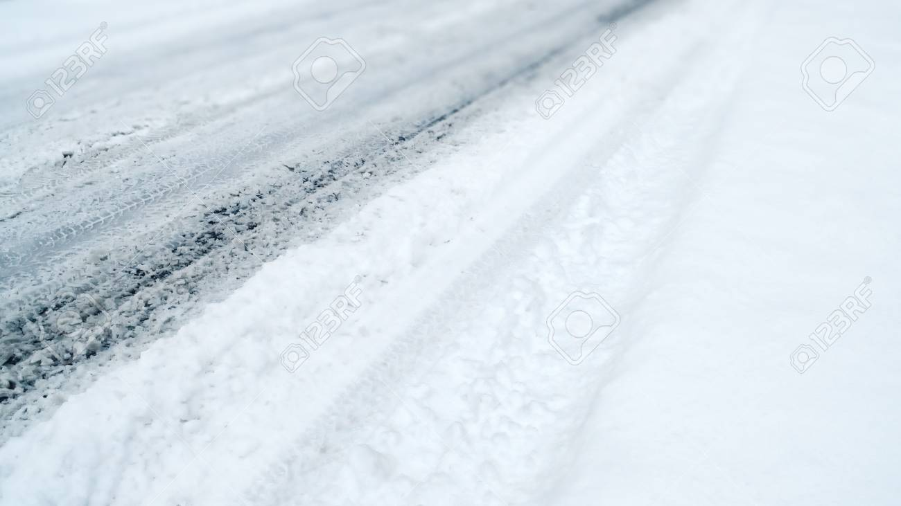 Winter Driving Background - snowy road with tire tracks - 113081641