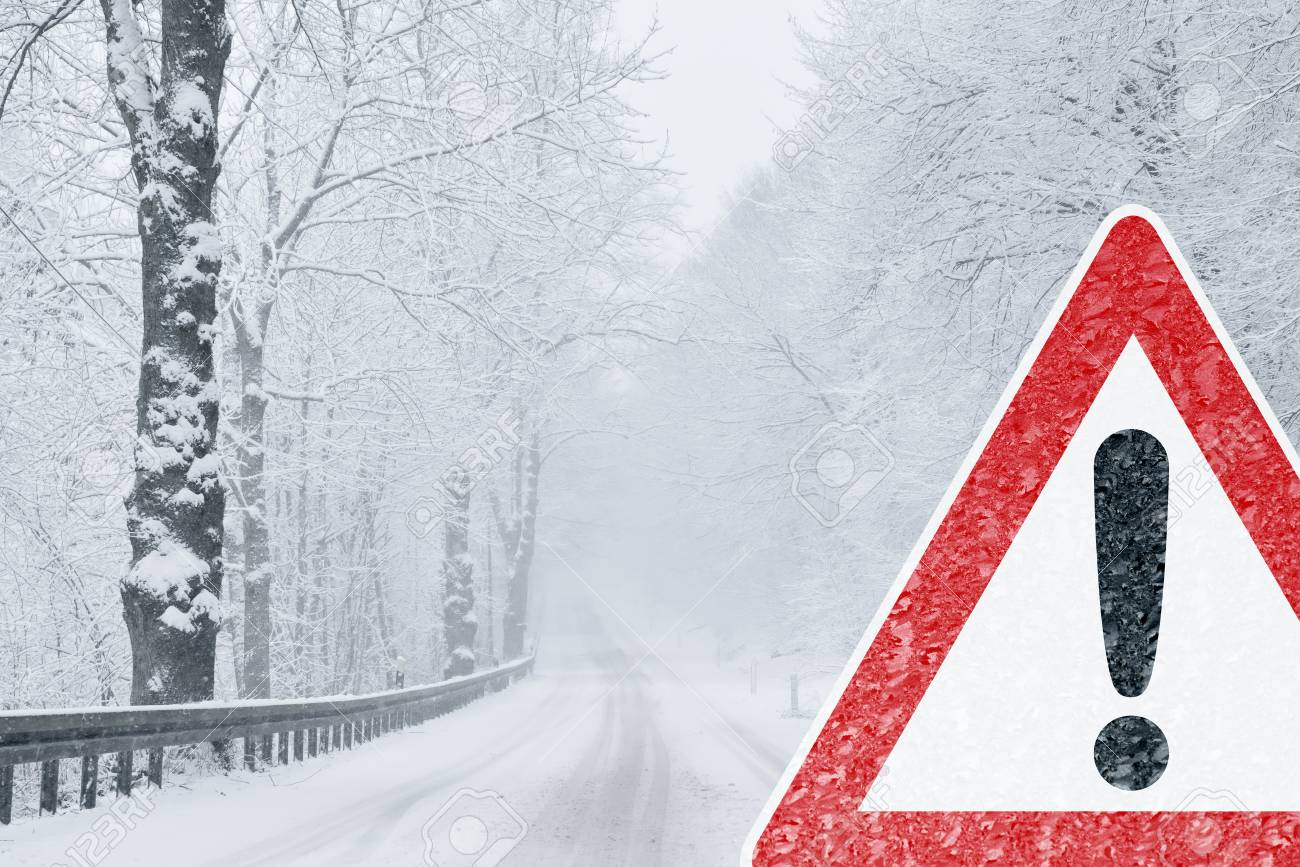 Winter Driving - Snowy Road with Warning Sign - 113081640