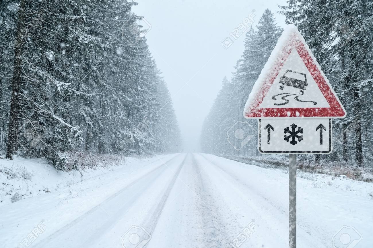 Winter Driving - Snowy Road with Warning Sign - 113081644
