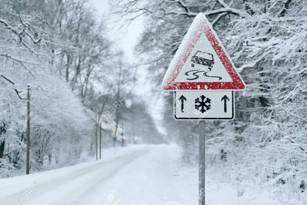 Winter Driving - Heavy snowfall on a country road. Driving on it is dangerous? - 113081650