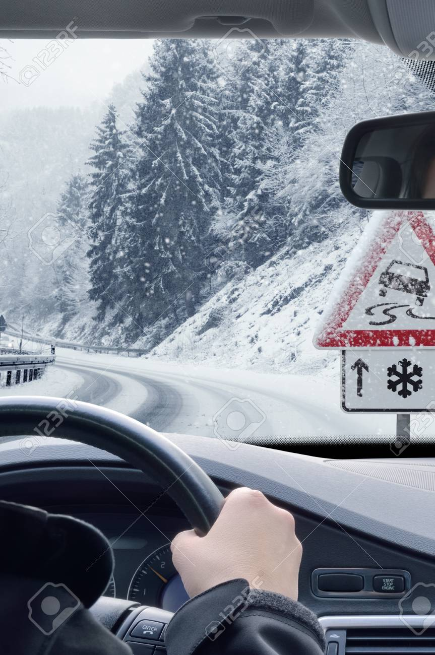 Winter Driving - Snowy Road with Warning Sign - 113081649