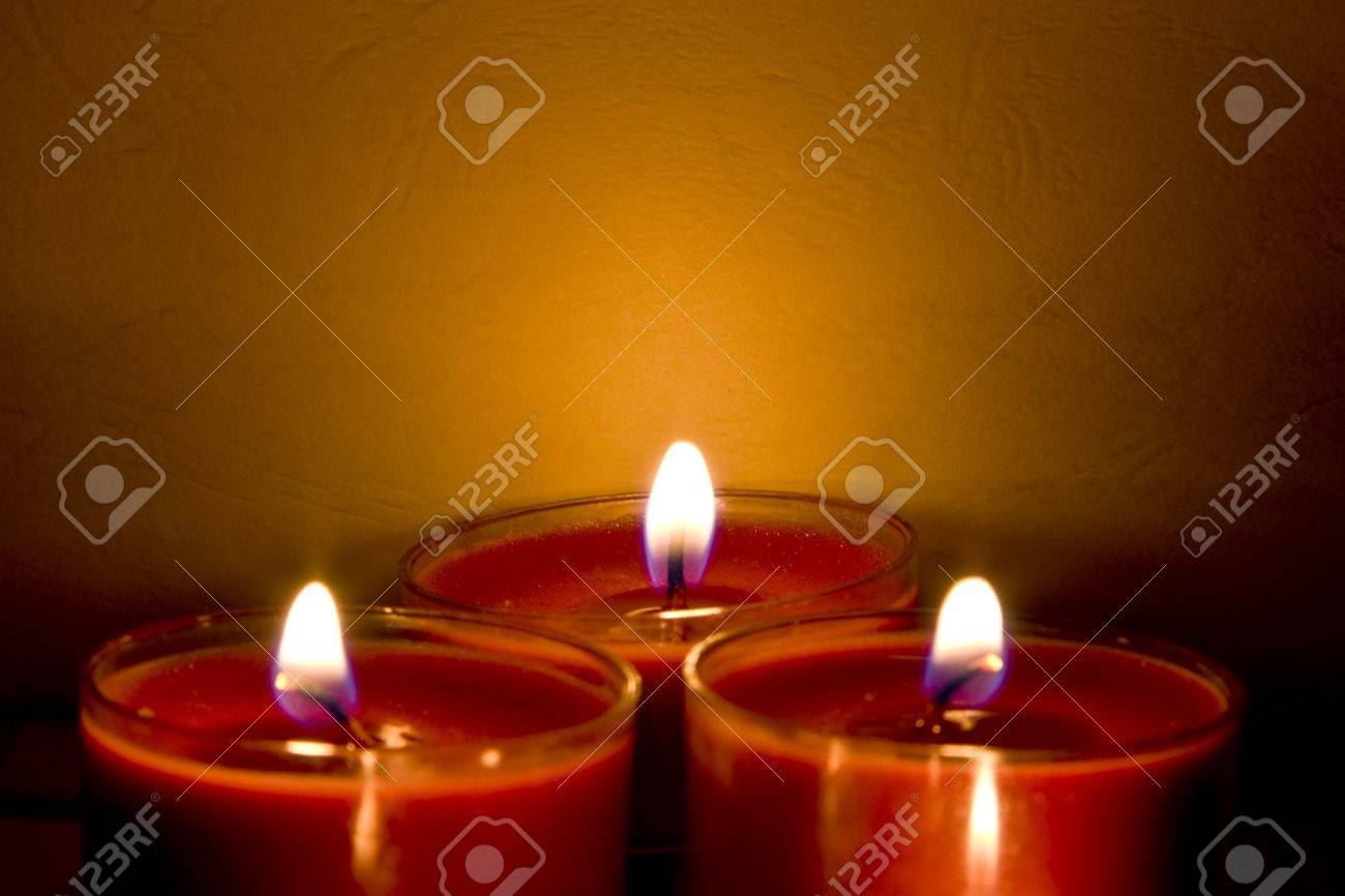 subdued lighting. Red Church Candles Burning In Subdued Lighting Stock Photo - 8591776 F