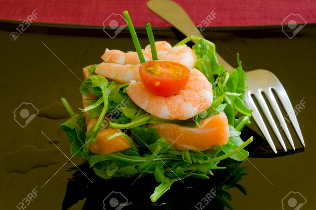 fresh salmon tartar on black platter with rocket salad Stock Photo - 1637420