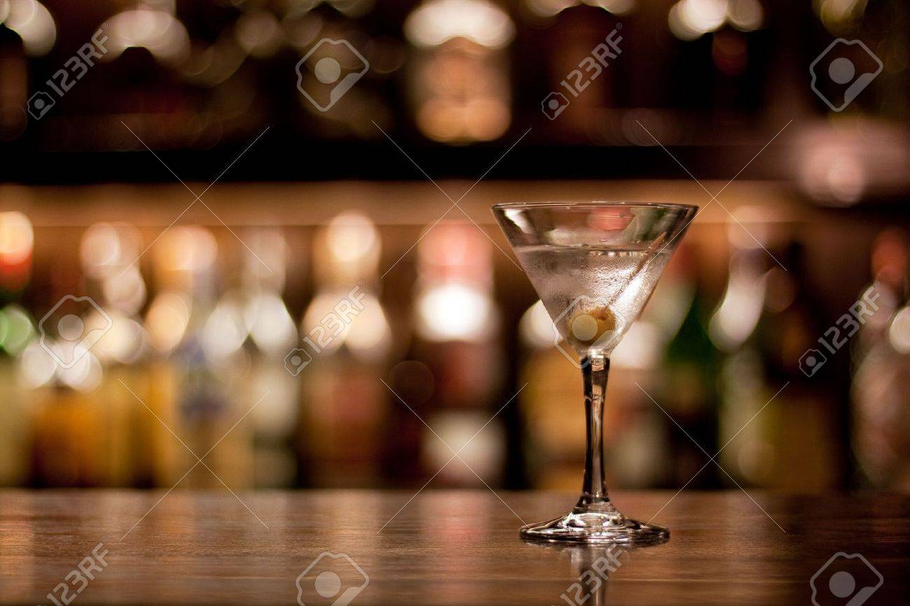 a cup of martini with olive on a old pub Stock Photo - 4719269