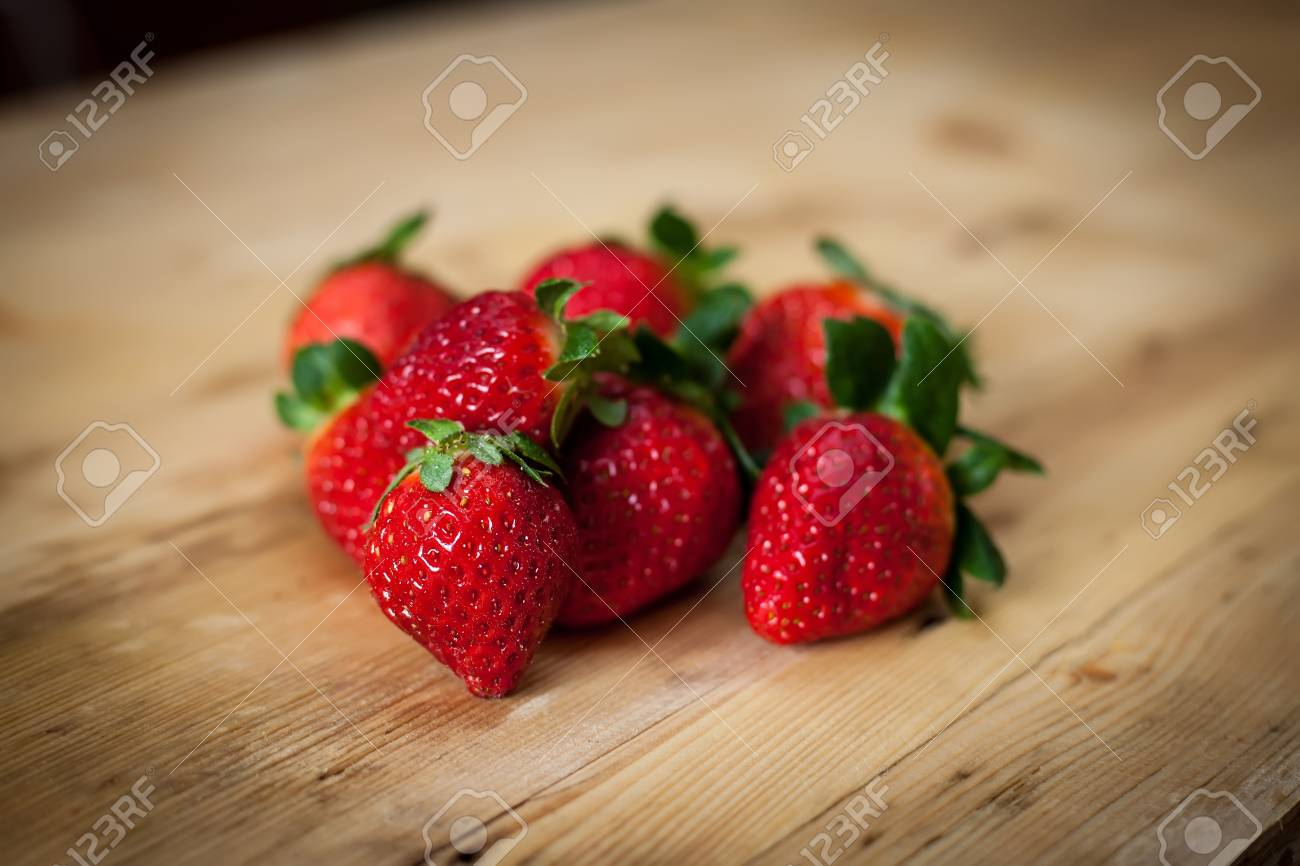 sweet and fresh red strawberries on wooden background Stock Photo - 12761903