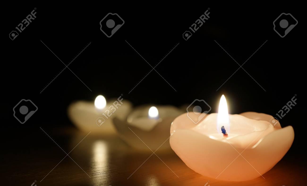 Burning Candle Isolated On Black Religious Symbol Stock Photo