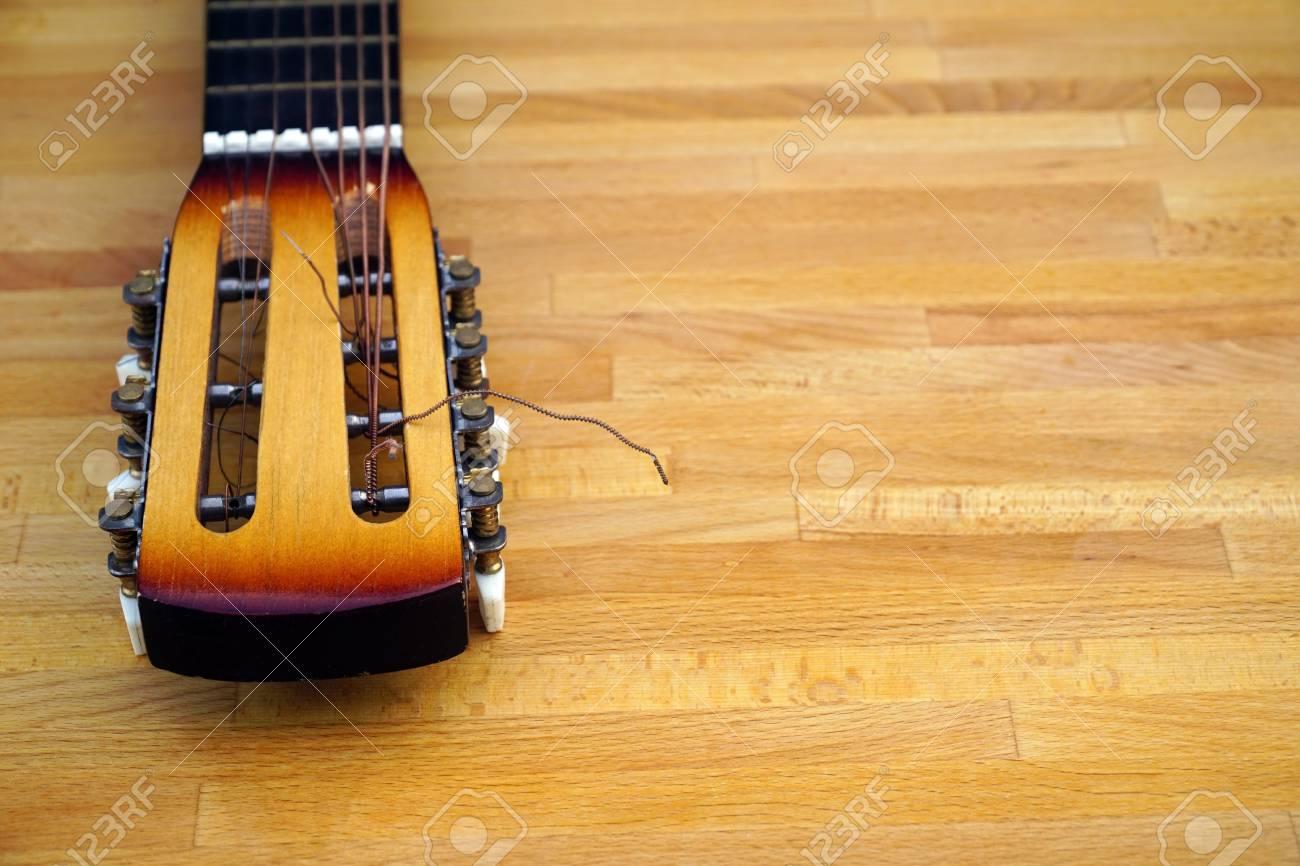 Instrumental wooden guitar close up  music background