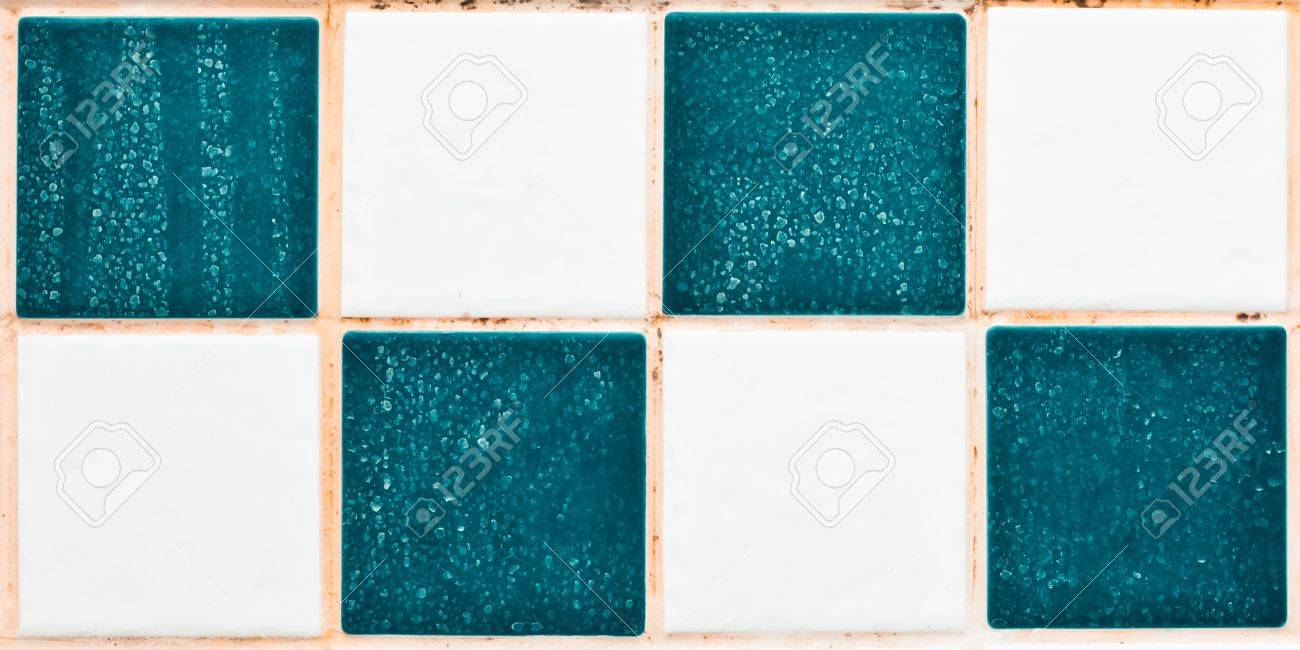 Close up of bathroom tiles showing mould and limescale Stock Photo - 12813569