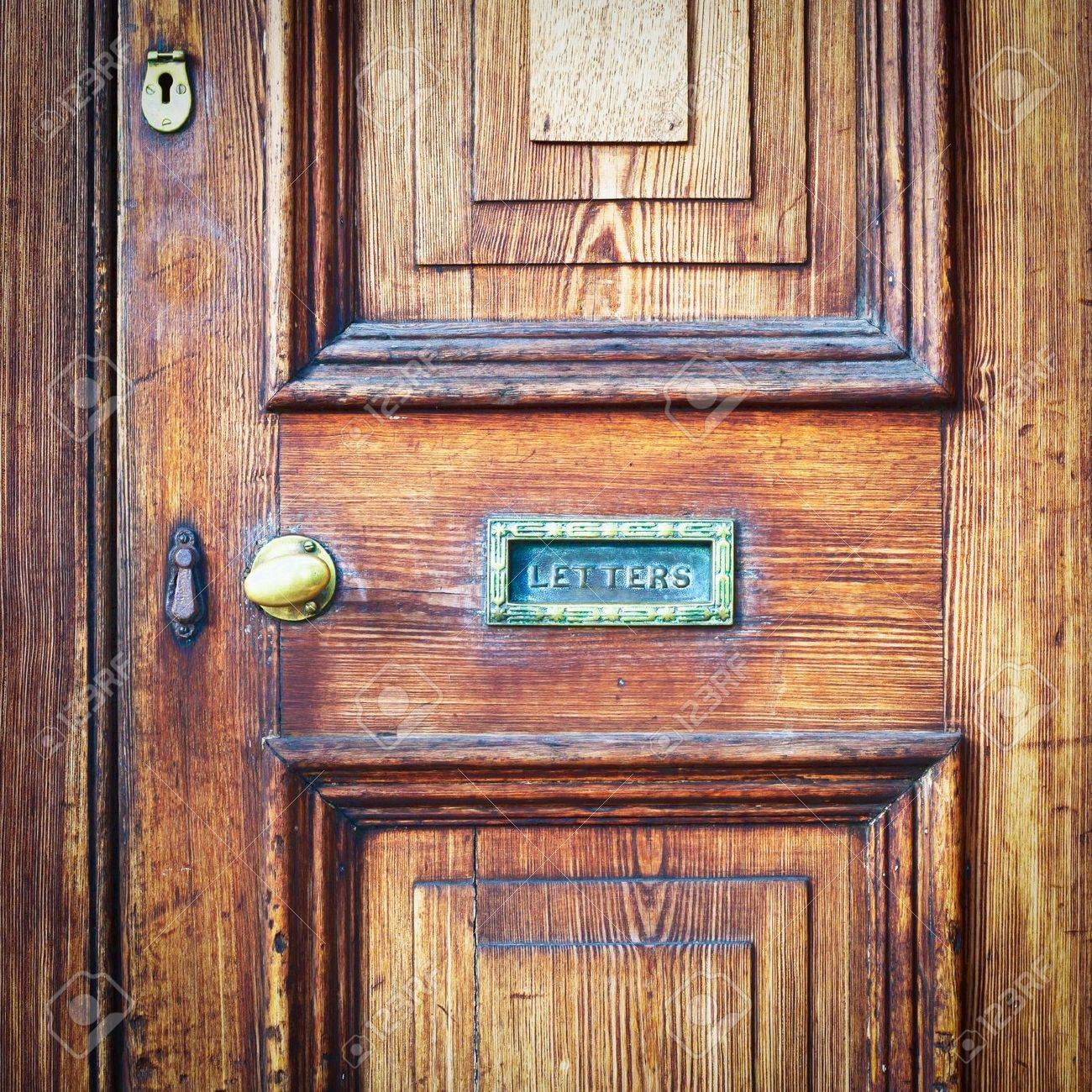 a wooden vintage front door with a letter box stock photo 15636535