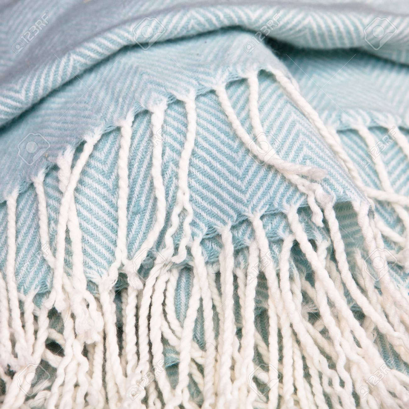Close up of the tassles of a soft fluffy blanket Stock Photo - 15761637