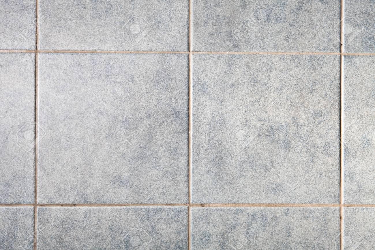 Close up di piastrelle quadrate grigie come sfondo foto royalty