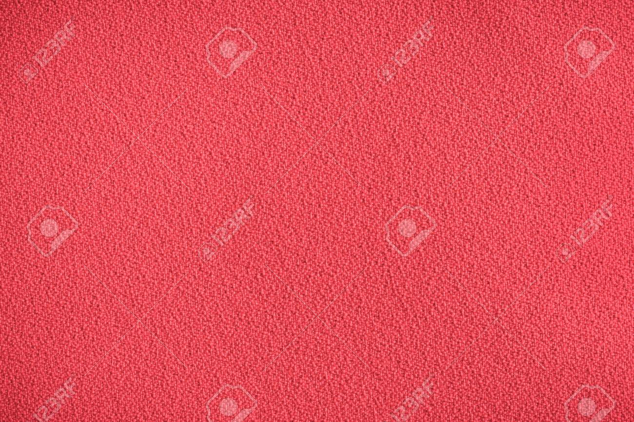 Red synthetic chair covering material as a background Stock Photo - 22526474