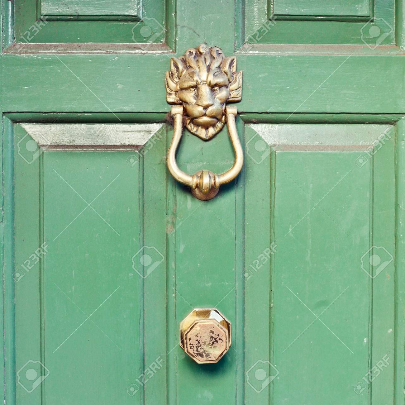 Brass Lion Head Door Knocker On A Green Front Door Stock Photo   24884432