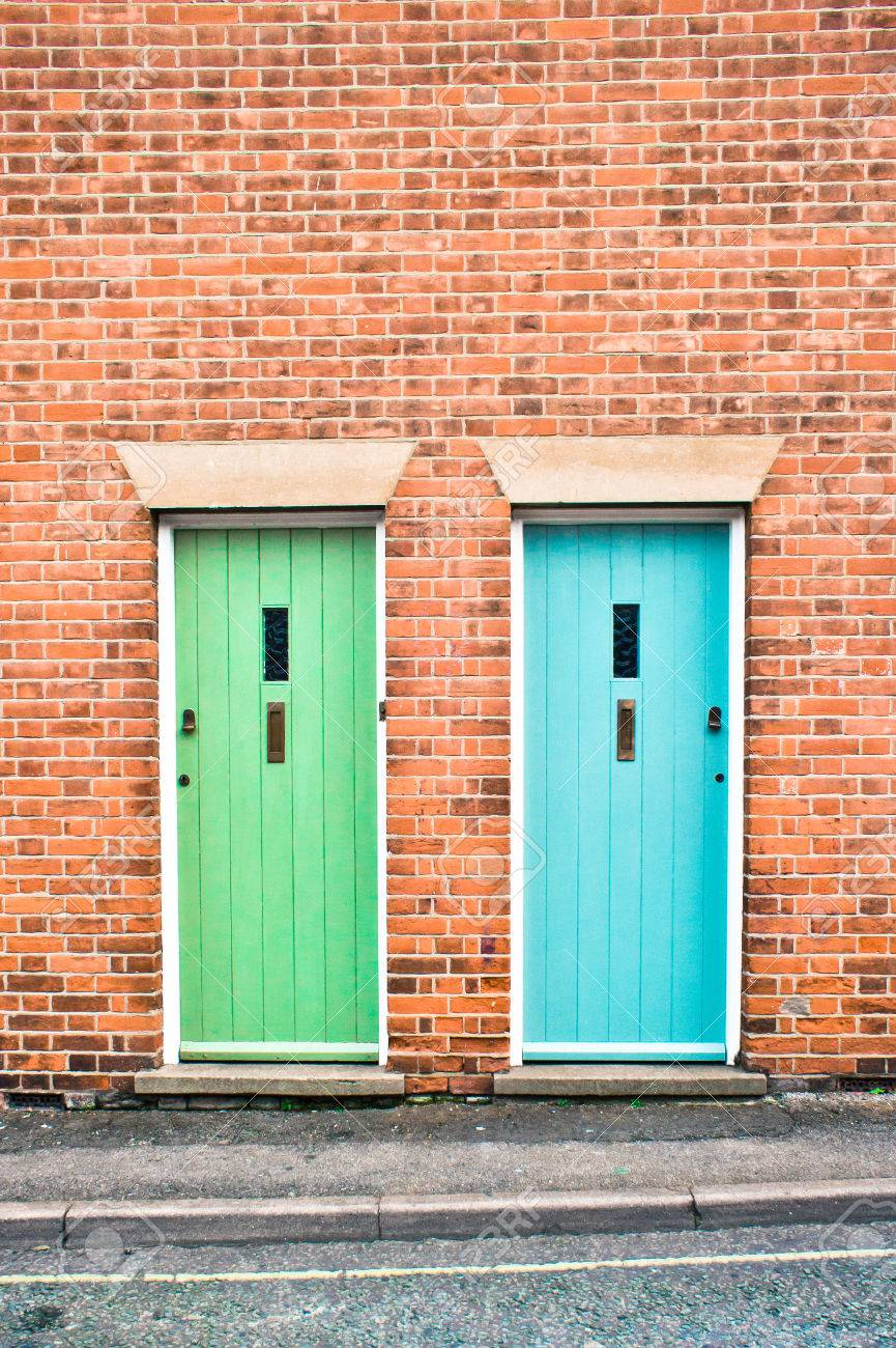 Blue and green front doors in adjoining houses Stock Photo - 27016717 & Blue And Green Front Doors In Adjoining Houses Stock Photo Picture ...