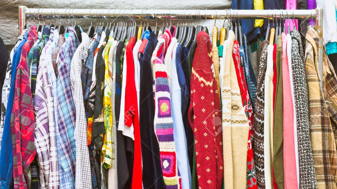 6d8a33ab5f Second hand clothes on sale at a market Stock Photo - 34372484