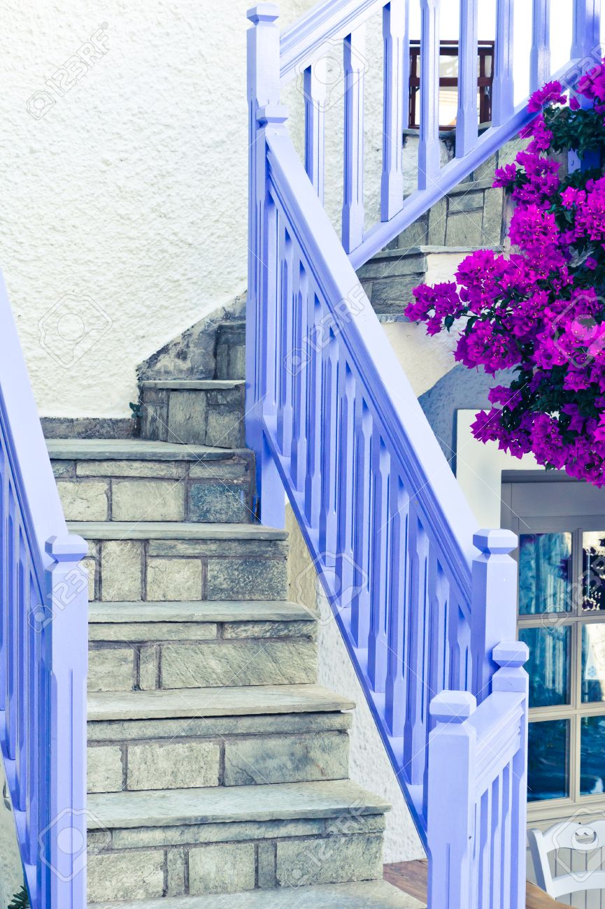Blue Wooden Railings With Stone Steps Outside A Greek House Stock