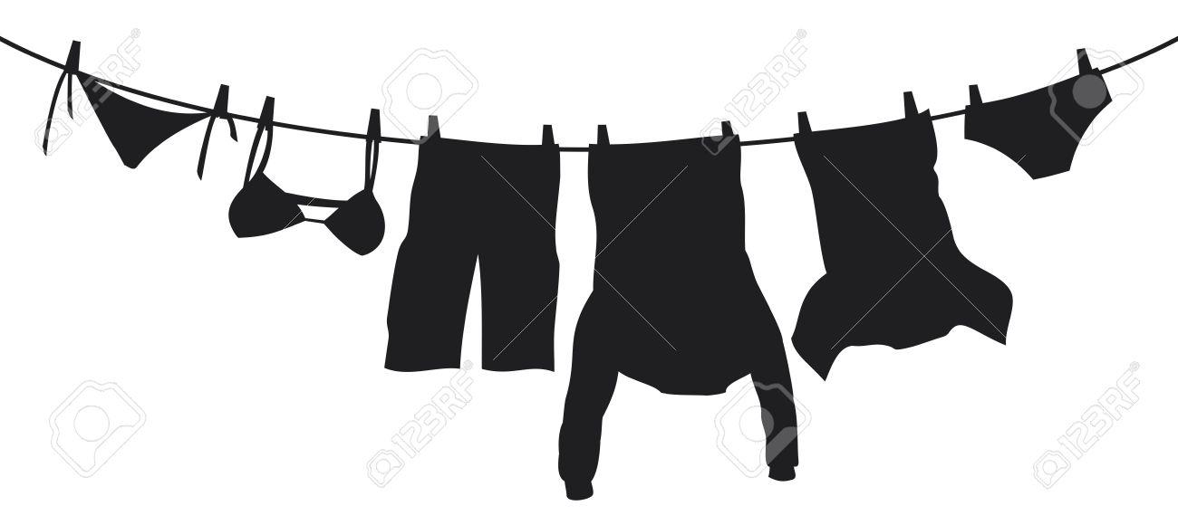 服を物干し綱に掛かっています。...